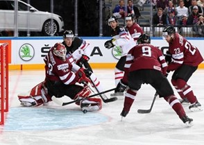 PRAGUE, CZECH REPUBLIC - MAY 1: Canada 's Nathan Mackinnon #29 with a scoring chance against Latvia's Ervins Mustukovs #33 while Jason Spezza #90, Janis Sprukts #5, Krisjanis Redlihs #9 and Aleksandrs Jerofejevs #23 look on during preliminary round action at the 2015 IIHF Ice Hockey World Championship. (Photo by Andre Ringuette/HHOF-IIHF Images)