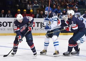 OSTRAVA, CZECH REPUBLIC - MAY 1: USA's Mark Arcobello #36 and Seth Jones #3 battle for a bouncing puck with Finland's Petri Kontiola #27 during preliminary round action at the 2015 IIHF Ice Hockey World Championship. (Photo by Richard Wolowicz/HHOF-IIHF Images)