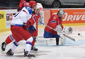 OSTRAVA, CZECH REPUBLIC - MAY 1: Norway's Lars Volden #31 reaches for a bouncing puck against Team Russia during preliminary round action at the 2015 IIHF Ice Hockey World Championship. (Photo by Richard Wolowicz/HHOF-IIHF Images)
