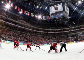 PRAGUE, CZECH REPUBLIC - MAY 2: Switzerland and Austria battle during preliminary round action at the 2015 IIHF Ice Hockey World Championship. (Photo by Andre Ringuette/HHOF-IIHF Images)