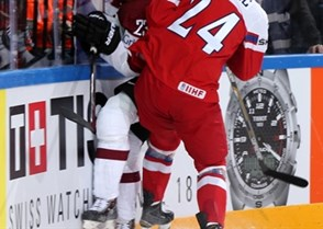 PRAGUE, CZECH REPUBLIC - MAY 2: The Czech Republic's Martin Zatovic #24 takes out Latvia's Aleksandrs Jerofejevs #23 along the boards during preliminary round action at the 2015 IIHF Ice Hockey World Championship. (Photo by Andre Ringuette/HHOF-IIHF Images)