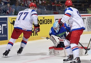 OSTRAVA, CZECH REPUBLIC - MAY 3: Slovenia's Luka Gracnar #40 tracks a bouncing puck with Russia's Anton Belov #77 and Artemi Panarin #9 in front during preliminary round action at the 2015 IIHF Ice Hockey World Championship. (Photo by Richard Wolowicz/HHOF-IIHF Images)