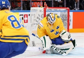 PRAGUE, CZECH REPUBLIC - MAY 3: Sweden's Anders Nilsson #31 goes down to make the save while Oscar Klefbom #84 looks on during preliminary round action at the 2015 IIHF Ice Hockey World Championship. (Photo by Andre Ringuette/HHOF-IIHF Images)