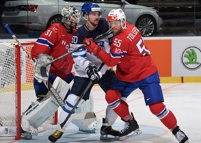 OSTRAVA, CZECH REPUBLIC - MAY 4: Finland's Juhamatti Aaltonen #50 battles for position with Norway's Ole-Kristian Tollefsen #55 in front of Lars Volden #31 during preliminary round action at the 2015 IIHF Ice Hockey World Championship. (Photo by Richard Wolowicz/HHOF-IIHF Images)