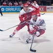 OSTRAVA, CZECH REPUBLIC - MAY 5: Belarus' Artyom Demkov #15 reaches for the puck with pressure from Denmark's Emil Kristensen #28 during preliminary round action at the 2015 IIHF Ice Hockey World Championship. (Photo by Richard Wolowicz/HHOF-IIHF Images)