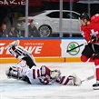 PRAGUE, CZECH REPUBLIC - MAY 6: Latvia's Edgars Maslaskis #31 sprawls out to make the save against Switzerland's Damien Brunner #96 during preliminary round action at the 2015 IIHF Ice Hockey World Championship. (Photo by Andre Ringuette/HHOF-IIHF Images)