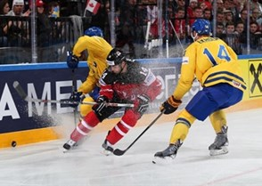 PRAGUE, CZECH REPUBLIC - MAY 6: Canada's Jordan Eberle #14 battles for the puck against Sweden's Johan Fransson #8 and Mattias Ekholm #14 during preliminary round action at the 2015 IIHF Ice Hockey World Championship. (Photo by Andre Ringuette/HHOF-IIHF Images)