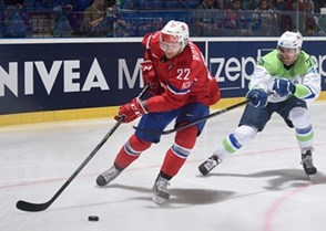 OSTRAVA, CZECH REPUBLIC - MAY 8: Norway's Martin Roymark #22 stickhandles the puck with Slovenia's Marcel Rodman #22 chasing during preliminary round action at the 2015 IIHF Ice Hockey World Championship. (Photo by Richard Wolowicz/HHOF-IIHF Images)