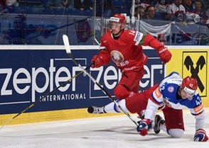 OSTRAVA, CZECH REPUBLIC - MAY 9: Belarus' Yevgeni Lisovets #14 collides with Russia's Artyom Anisimov #42 during preliminary round action at the 2015 IIHF Ice Hockey World Championship. (Photo by Richard Wolowicz/HHOF-IIHF Images)