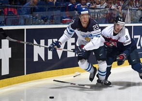 OSTRAVA, CZECH REPUBLIC - MAY 9: Finland's Ossi Louhivaara #23 stickhandles the puck away from Slovakia's Michal Sersen #8 during preliminary round action at the 2015 IIHF Ice Hockey World Championship. (Photo by Richard Wolowicz/HHOF-IIHF Images)