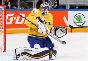 PRAGUE, CZECH REPUBLIC - MAY 11: Sweden's Jhonas Enroth #1 makes the save during preliminary round action against France at the 2015 IIHF Ice Hockey World Championship. (Photo by Andre Ringuette/HHOF-IIHF Images)