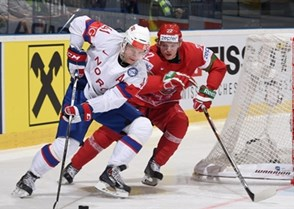 OSTRAVA, CZECH REPUBLIC - MAY 12: Norway's Patrick Thoresen #41 stickhandles the puck away from Belarus' Oleg Goroshko #22 during preliminary round action at the 2015 IIHF Ice Hockey World Championship. (Photo by Richard Wolowicz/HHOF-IIHF Images)