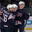 OSTRAVA, CZECH REPUBLIC - MAY 12: USA's Ben Smith #12 celebrates with Mark Arcobello #36 and Jimmy Vesey #19 after scoring Team USA's first goal of the game during preliminary round action at the 2015 IIHF Ice Hockey World Championship. (Photo by Richard Wolowicz/HHOF-IIHF Images)