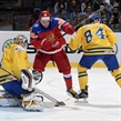 OSTRAVA, CZECH REPUBLIC - MAY 14: Sweden's Jhonas Enroth #1 jumps on a loose puck with Sweden's Oscar Klefbom #84 and Russia's Sergei Plotnikov #16 battling in front during quarterfinal round action at the 2015 IIHF Ice Hockey World Championship. (Photo by Richard Wolowicz/HHOF-IIHF Images)